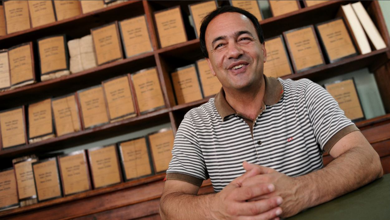 (FILES) In this file photo taken on June 22, 2011, Riace mayor, Domenico Lucano poses in his office. The Prosecutor's Office of Locri in Calabria announced on October 2, 2018 the arrest of Lucano, the mayor of Riace, a small village that has been hosting migrants and asylum seekers for years, on the grounds of suspected aid to illegal immigration.