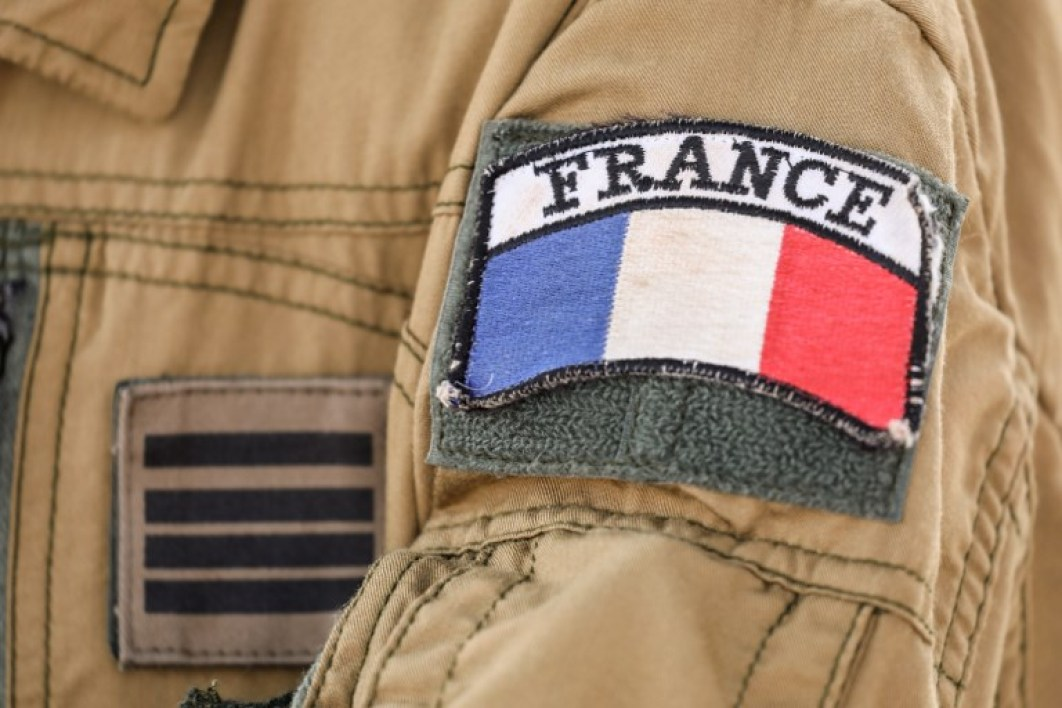 The badge of France's Barkhane mission in Africa's Sahel region, is seen on a soldier's uniform, on the French Air Force base in Niamey on December 22, 2017.  ludovic MARIN / AFP