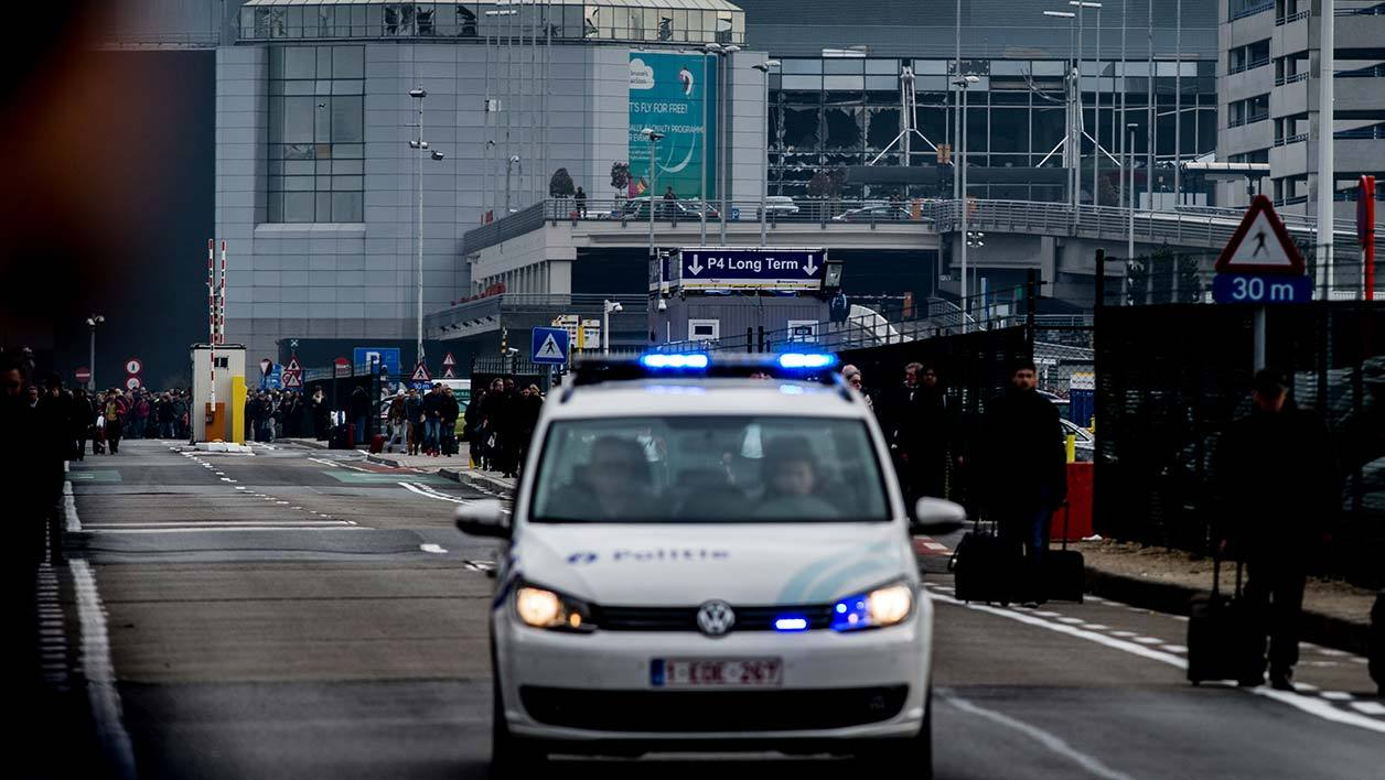 A photo taken on March 22, 2016 shows Brussels Airport, in Zaventem, after two explosions rocked the main hall of the airport. At least 13 people have been killed after two explosions occured in the departure hall of Brussels Airport. Government sources speak of a terrorist attack. The terrorist threat level has been heightened to four across the country. DIRK WAEM / BELGA / AFP