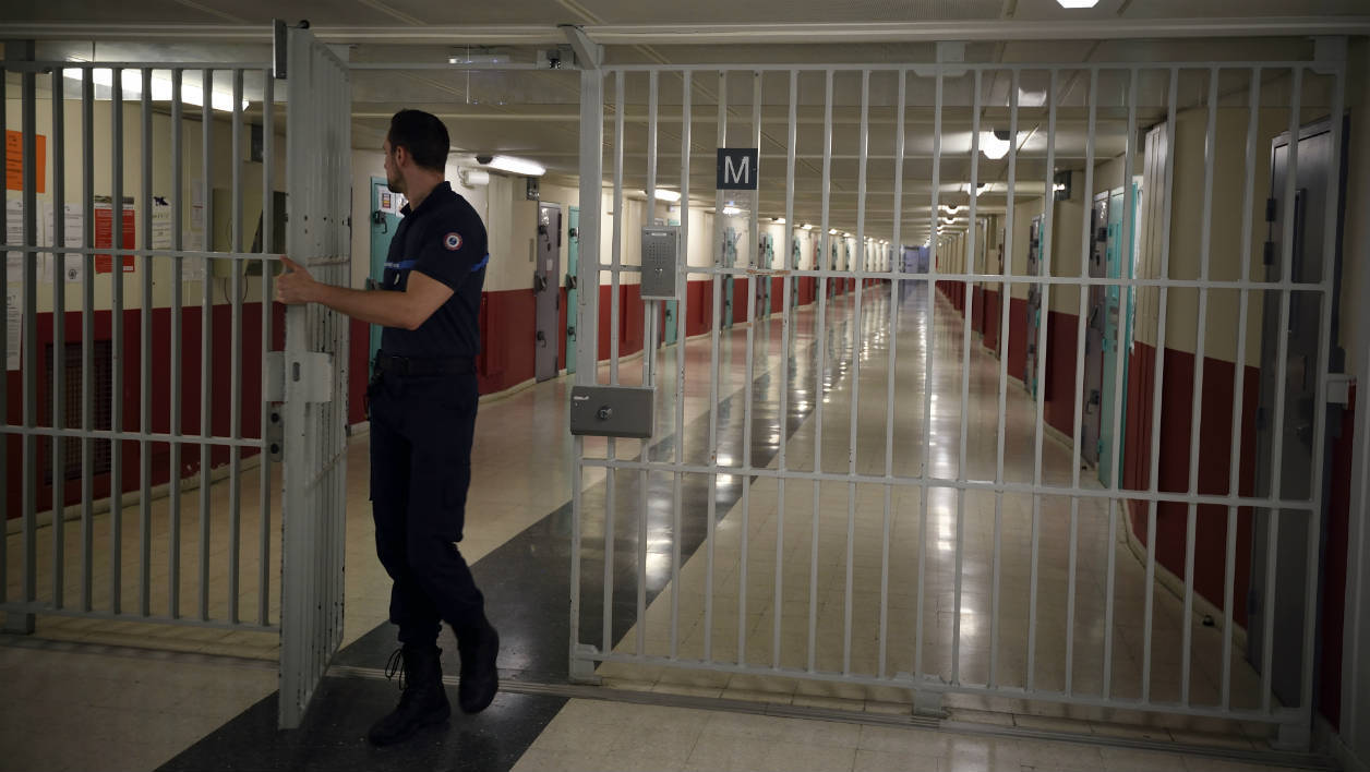 TO GO WITH AFP STORY BY ALEXANDRE HIELARD A prison officer closes the gate to a hallway to prison cells at the Fleury-Merogis prison, south of Paris, on October 29, 2015.