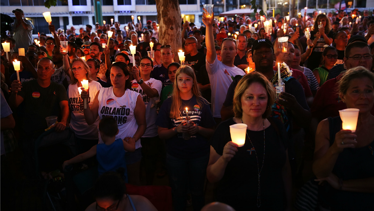 ORLANDO, FL - JUNE 19: People attend a memorial service on June 19, 2016 in Orlando, Florida. Thousands of people are expected at the evening event which will feature entertainers, speakers and a candle vigil at sunset.