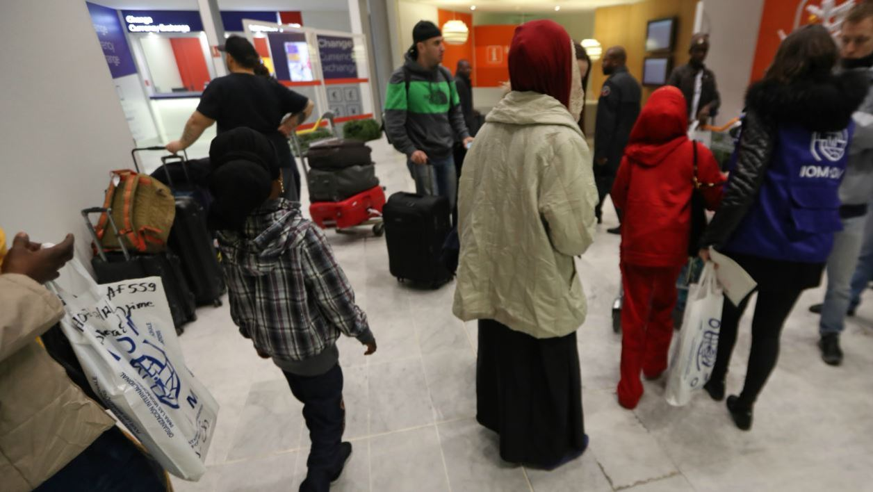 Sudanese refugees coming from Chad arrive to the Roissy-Charles de Gaulle airport, near to Paris, on December 18, 2017, as part of the first group from missions from the French Office for the Protection of Refugees and Stateless People in Africa (OFPRA).