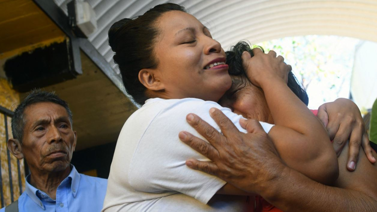 Teodora Vasquez (C) hugs her mother shortly after being released from the women's Readaptation Center, in Ilopango, El Salvador on February 15, 2018, where she was serving a sentence since 2008, handed down under draconian anti-abortion laws after suffering a miscarriage.