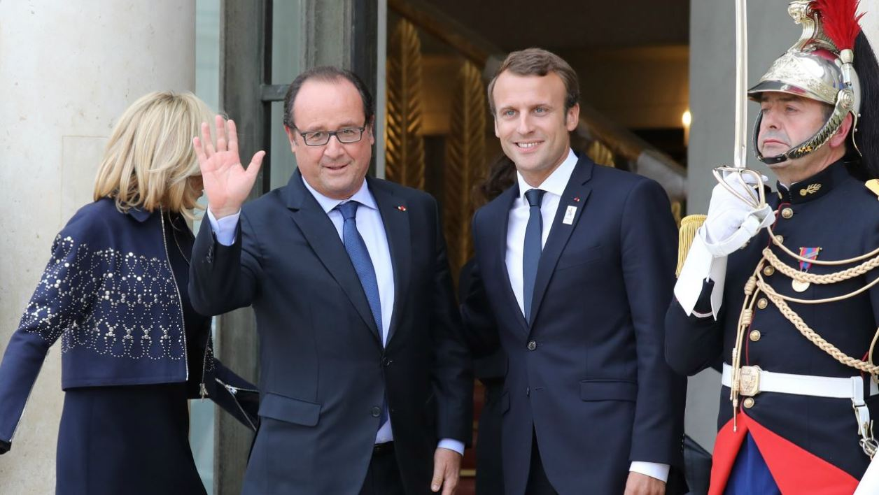 French President Emmanuel Macron (R) welcomes former French president Francois Hollande (C) for a welcoming ceremony to celebrate Paris' coronation as host of the 2024 Olympics Games at the Elysee Palace in Paris on September 15, 2017, after the Paris 2024 delegation returned from the International Olympic Committee (IOC) meeting in Lima.