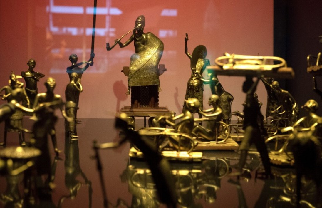 This file photo shows the Ato ceremony of the Kingdom of Dahomey, circa 1934 on May 18, 2018 at the Quai Branly Museum-Jacques Chirac in Paris. Experts appointed by President Emmanuel Macron will advise him on November 23, 2018 to allow the return of thousands of African artworks held in French museums, a radical shift in policy which could put pressure on other former colonial powers. GERARD JULIEN / AFP