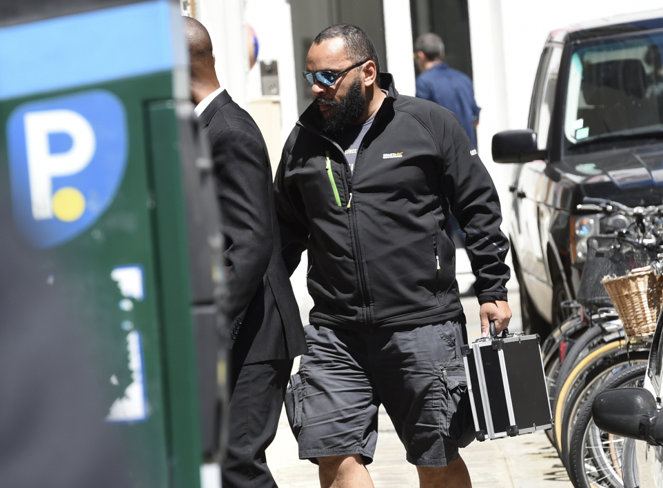 "Controversial humorist Dieudonne M'Bala M'Bala (R) arrives at the Theatre de la Main d'Or to take part in the event ""I am not Charlie..."", on June 27, 2015 in Paris. AFP PHOTO / LOIC VENANCE"
