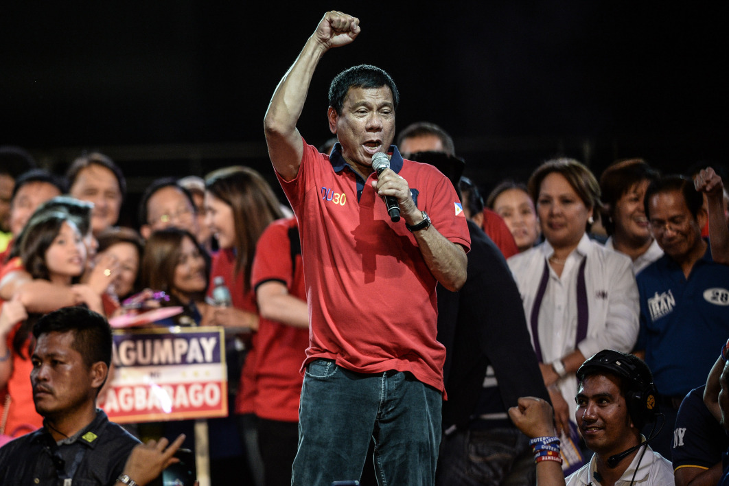 Presidential candidate Davao Mayor Rodrigo Duterte speaks to supporters during an election campaign rally ahead of the presidential and vice presidential elections in Manila on May 7, 2016.