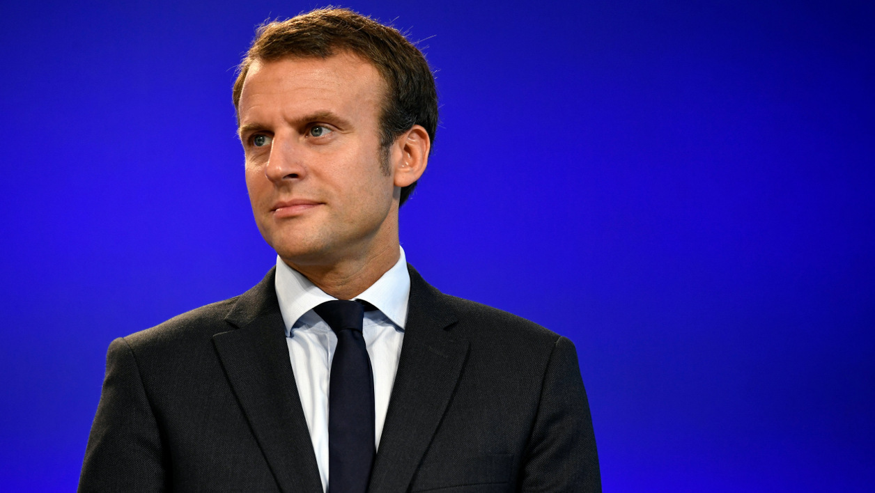 """France's former Minister of the Economy Emmanuel Macron looks on after handling over power to French Minister of Finance and also current Minister of Economy Michel Sapin in Paris, on August 31, 2016 following his resignation as economy minister. France's Emmanuel Macron vowed after stepping down as economy minister on August 30, 2016 to """"transform"""" an ailing country but stopped short of declaring a presidential run. The 38-year-old said he had """"seen at first hand the limits of our political system"""" and that quitting the government of President Francois Hollande would enable him """"to be free"""" to push forward his own agenda.  PHILIPPE LOPEZ / AFP"""
