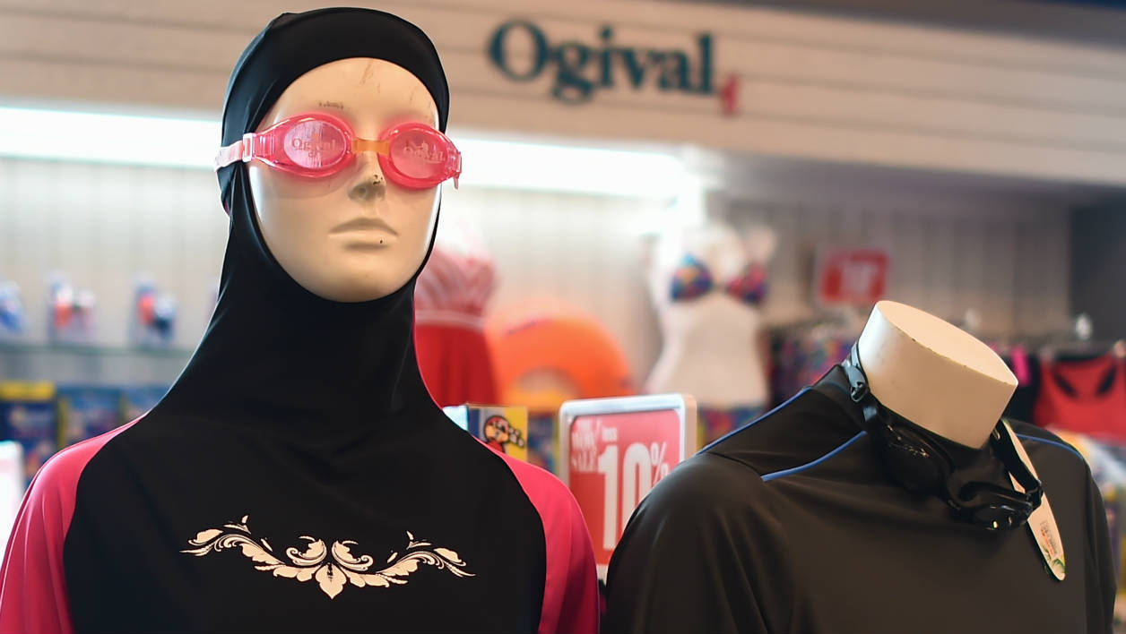 "A ""burkini"" full-body swimsuit (L) designed for Muslim women is seen on a mannequin at a shopping mall in Kuala Lumpur on August 16, 2016. The French resort of Cannes won court backing for its ""burkini ban"" on August 13, as a judge refused to overturn its decision to forbid Muslim women from wearing the full-body swimsuit."