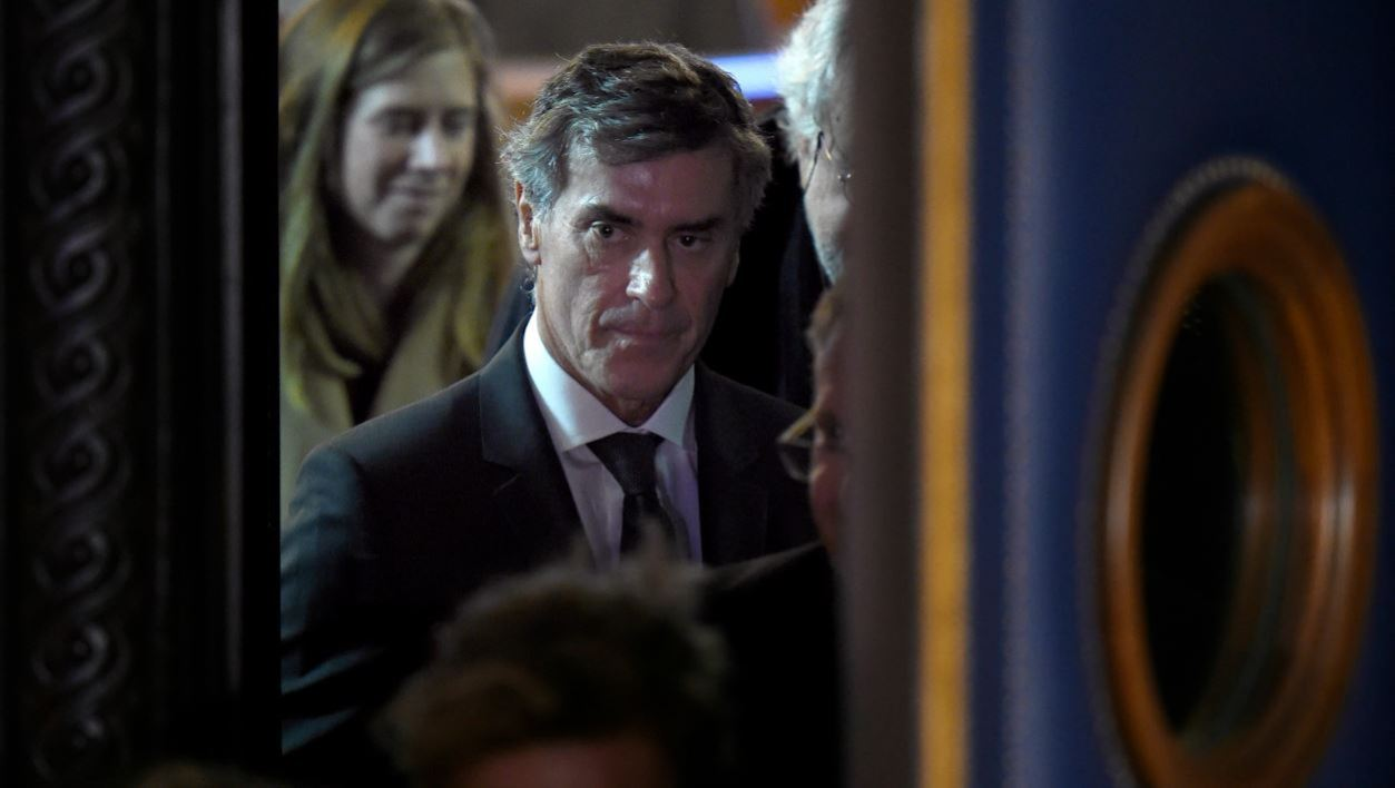 Former French budget minister Jerome Cahuzac (C) leaves the courtroom after the first day of his trial for tax fraud, on February 8, 2016, at the courthouse of Paris. Cahuzac, 63, who resigned in disgrace in 2013 after admitting to having a secret Swiss bank account, faces up to seven years in jail and two million euros (USD 2.2 million) in fines if found guilty of stashing offshore his earnings from a lucrative hair-transplant business he ran with his now ex-wife.