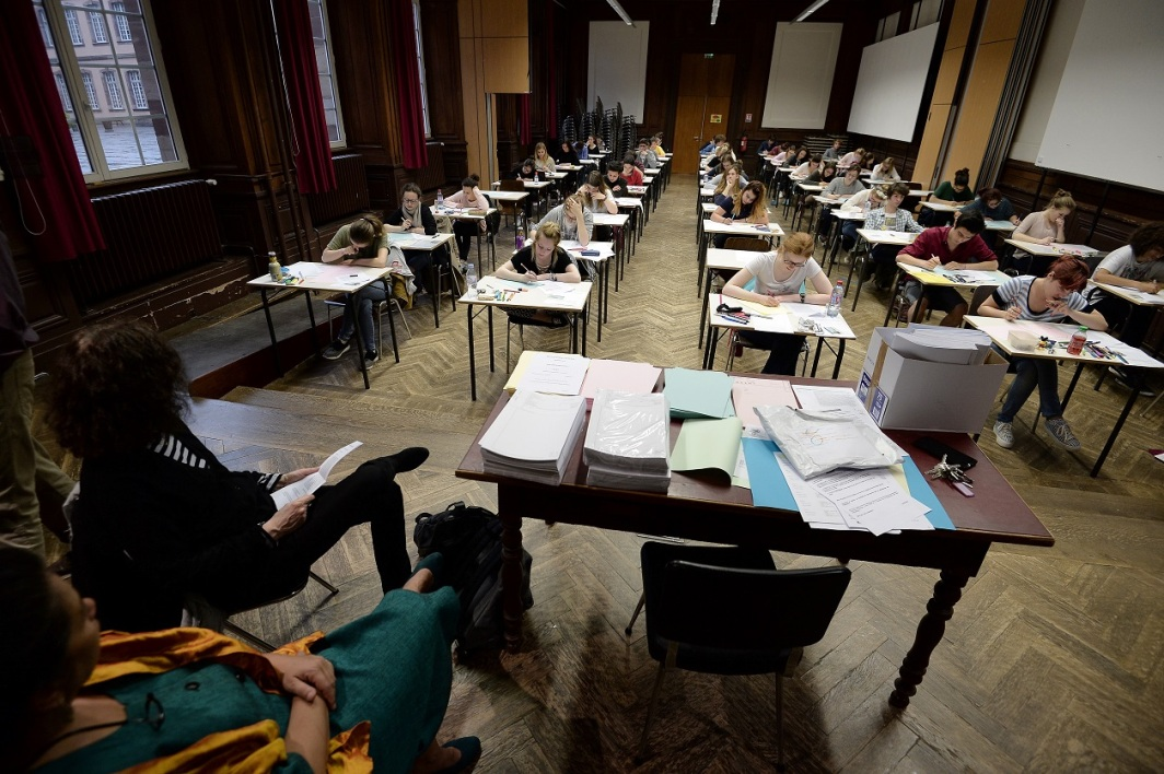 High school students take the philosophy exam, the first test session of the 2016 baccalaureate (high school graduation exam) on June 15, 2016 at the Fustel de Coulanges high school in Strasbourg, eastern France. A total of 695.682 Students across France are registered to take their written baccalaureat exams at over 4,200 examination centres across France through June 15 - 22, 2016. FREDERICK FLORIN / AFP
