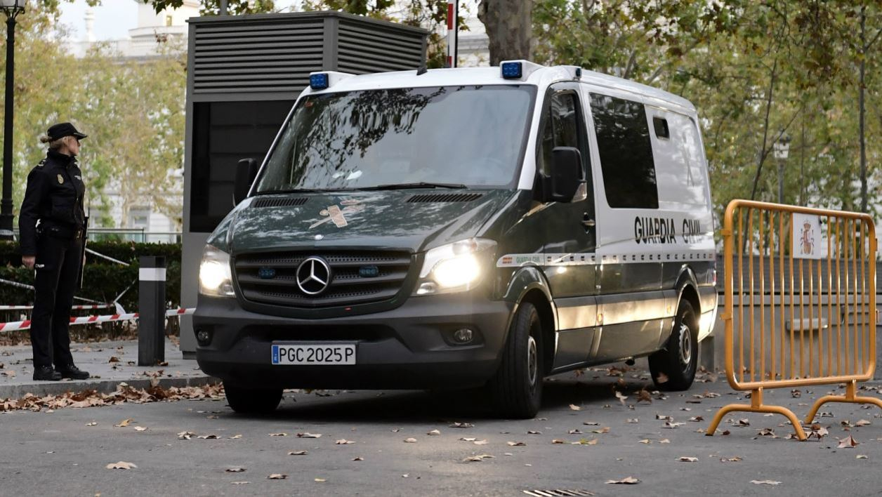 A Spanish Guardia Civil vehicle believed to be transporting members of the deposed Catalan regional government leaves the National Court in Madrid on November 2, 2017 after a judge ordered their detention.