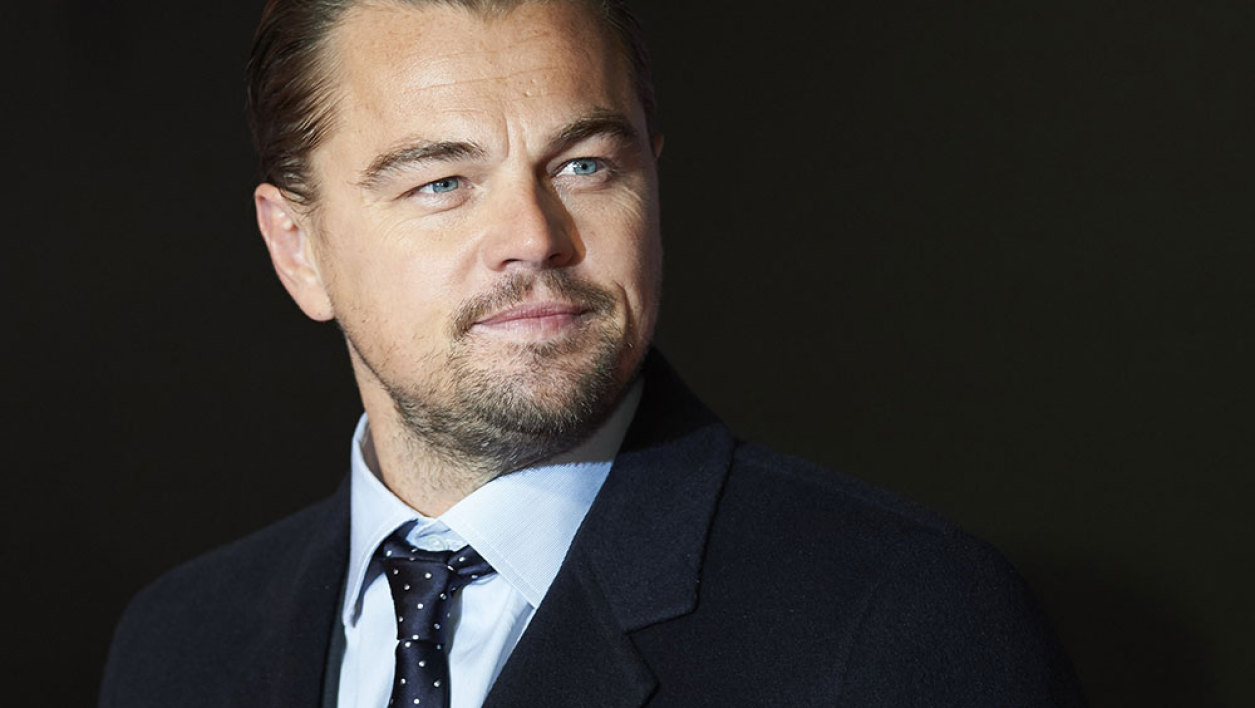 US actor Leonardo DiCaprio poses on arrival for the premiere of the film 'The Revenant' in London on January 14, 2016.