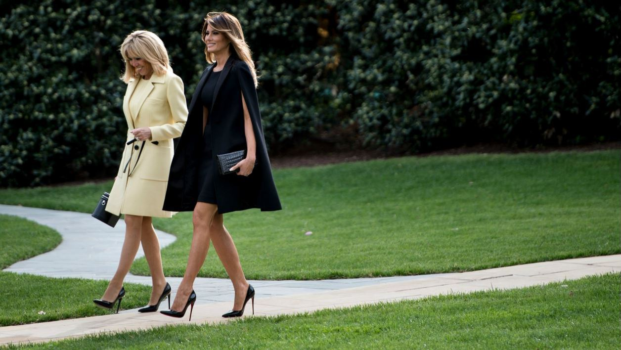 Brigitte Macron and Lady Melania Trump walk after a tree planting ceremony with French President Emmanuel Macron and US President Donald Trump on the South Lawn of the White House in Washington, DC, on April 23, 2018.  Brendan Smialowski / AFP