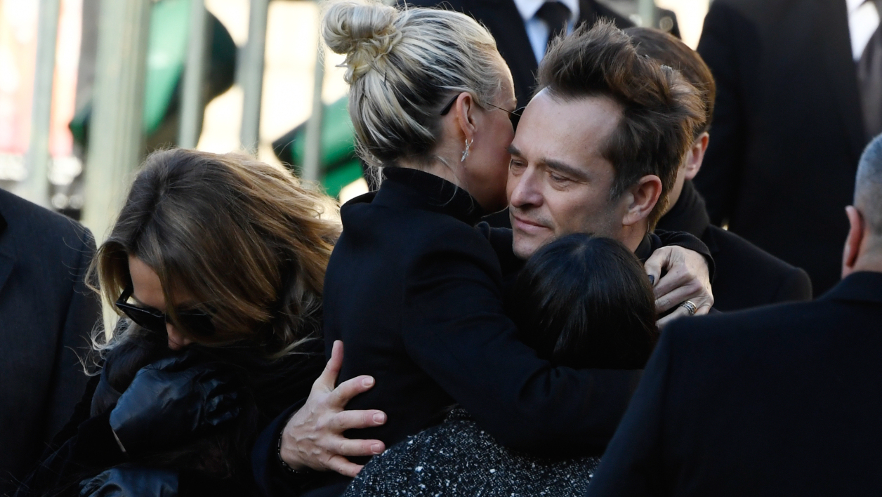 Son of late French singer Johnny Hallyday David Hallyday (R) and daughters Laura Smet (L) Joy Hallyday, Jade Hallyday and wife French singer Johnny Hallyday Laeticia Hallyday embrace at the Eglise de la Madeleine (Madeleine Church) at the start of the funeral ceremony for their late father on December 9, 2017 in Paris.