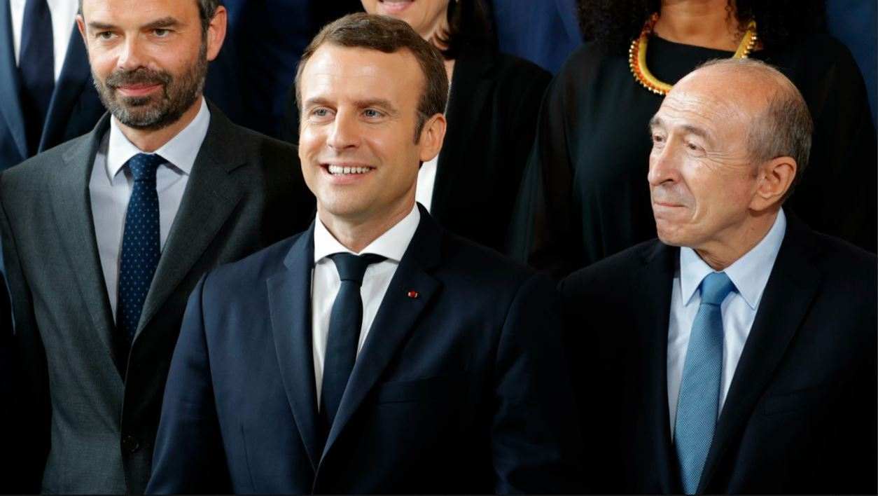French President Emmanuel Macron (C), Prime Minister Edouard Philippe (L) and Interior Minister Gerard Collomb pose during a family photo at the Elysee Palace in Paris, May 18, 2017.  PHILIPPE WOJAZER / POOL / AFP