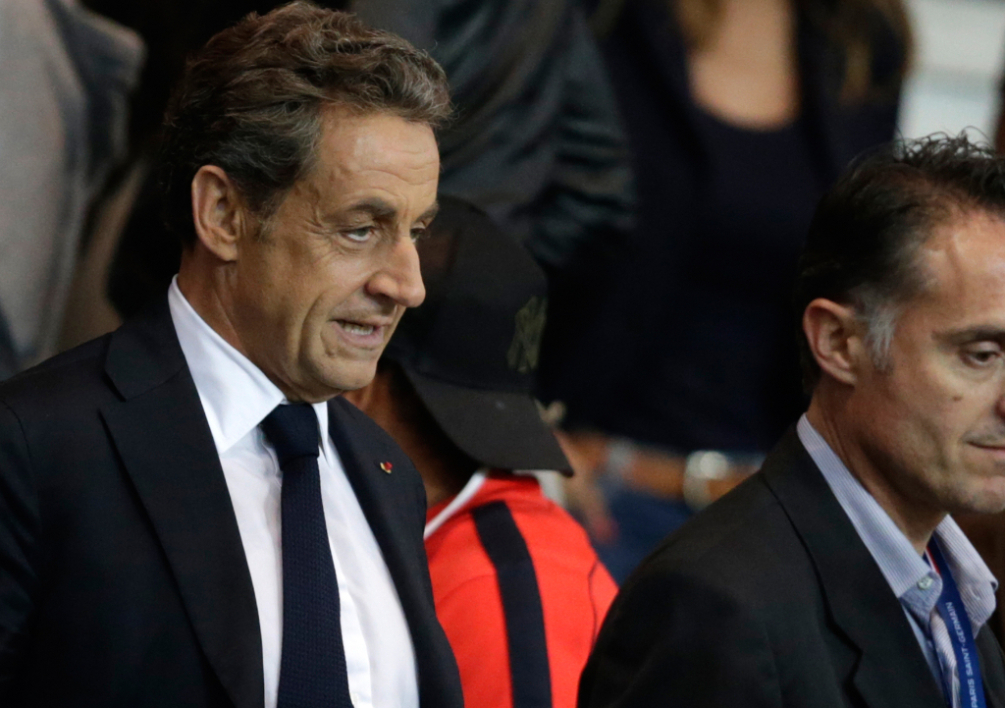 FRANCE, Paris : Former French president Nicolas Sarkozy looks on from the tribunes after the French L1 football match Paris Saint-Germain (PSG) vs Lyon (OL) on September 21, 2014 at the Parc des Princes stadium in Paris. AFP PHOTO / KENZO TRIBOUILLARD