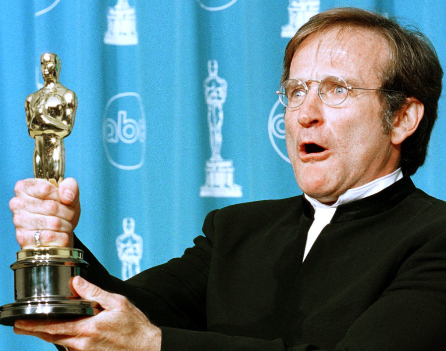 "UNITED STATES, Los Angeles : (FILES) In this March 23, 1998 file photo, actor Robin Williams holds the Oscar he won for Best Supporting Actor for his role in ""Good Will Hunting"" during the 70th Annual Academy Awards 23 March in Los Angeles, CA. An outpouring of grief and homage greeted word that Oscar-winning actor and comedian Robin Williams had apparently taken his own life after a battle with depression.The 63-year-old known for high-energy, rapid-fire improvisation and clowning was one of the most beloved entertainers of his time. One publication once called him the funniest man alive. The star of films such as ""Good Will Hunting,"" ""Good Morning Vietnam"" and ""Mrs Doubtfire"" was found dead at his home in Tiburon, in California just north of San Francisco, shortly before midday on August 11, 2014, police said. AFP PHOTO / Hal GARB / FILES"