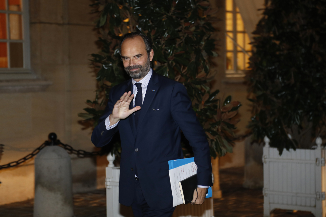 "French Prime minister Edouard Philippe waves as he meets parties and movements leaders on December 3, 2018 at the Hotel Matignon in Paris, as part of concertations on the ""Gilets jaunes"" (yellow vests) crisis.  FRANCOIS GUILLOT / AFP"