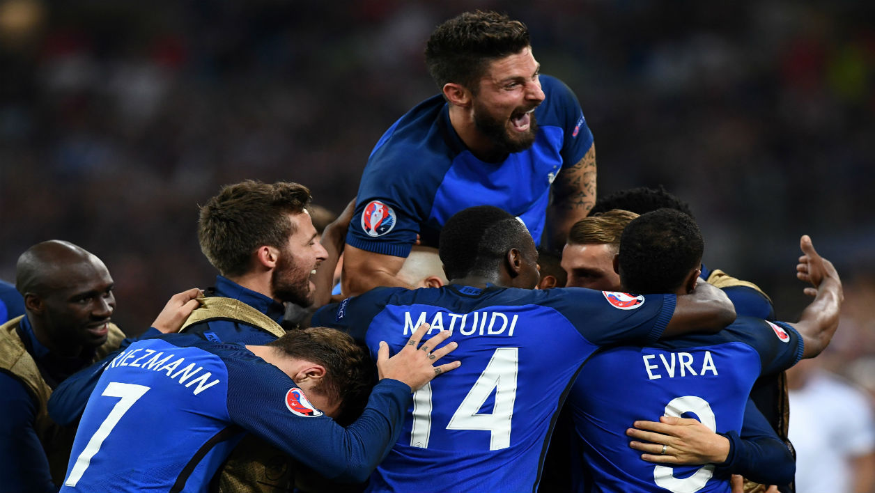 France's forward Olivier Giroud (top) and teammates celebrate during the Euro 2016 group A football match between France and Albania at the Velodrome stadium in Marseille on June 15, 2016. France beat Albania 2-0.