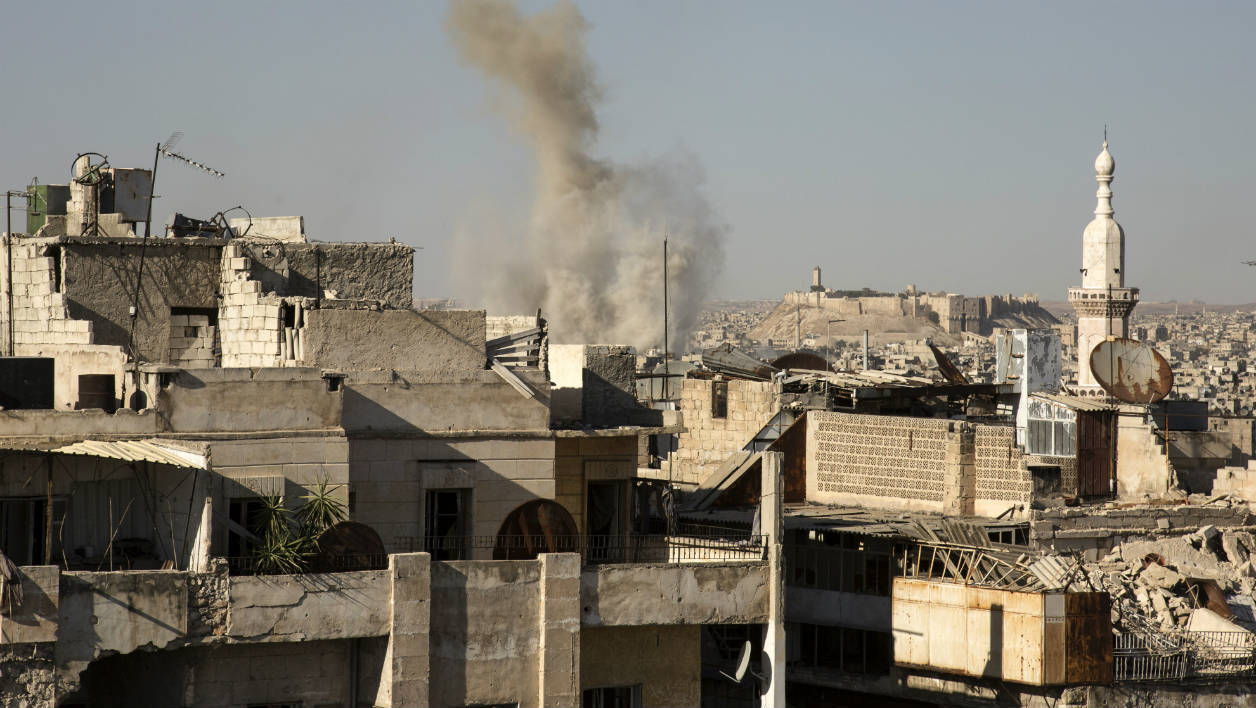 Smoke billows following a reported strike by pro-Syrian government forces in a rebel-held neighbourhood in the northern city of Aleppo on July 12, 2016. Syria's army has extended a nationwide truce for another three days, but continued to press its campaign against rebels in the battered northern city of Aleppo
