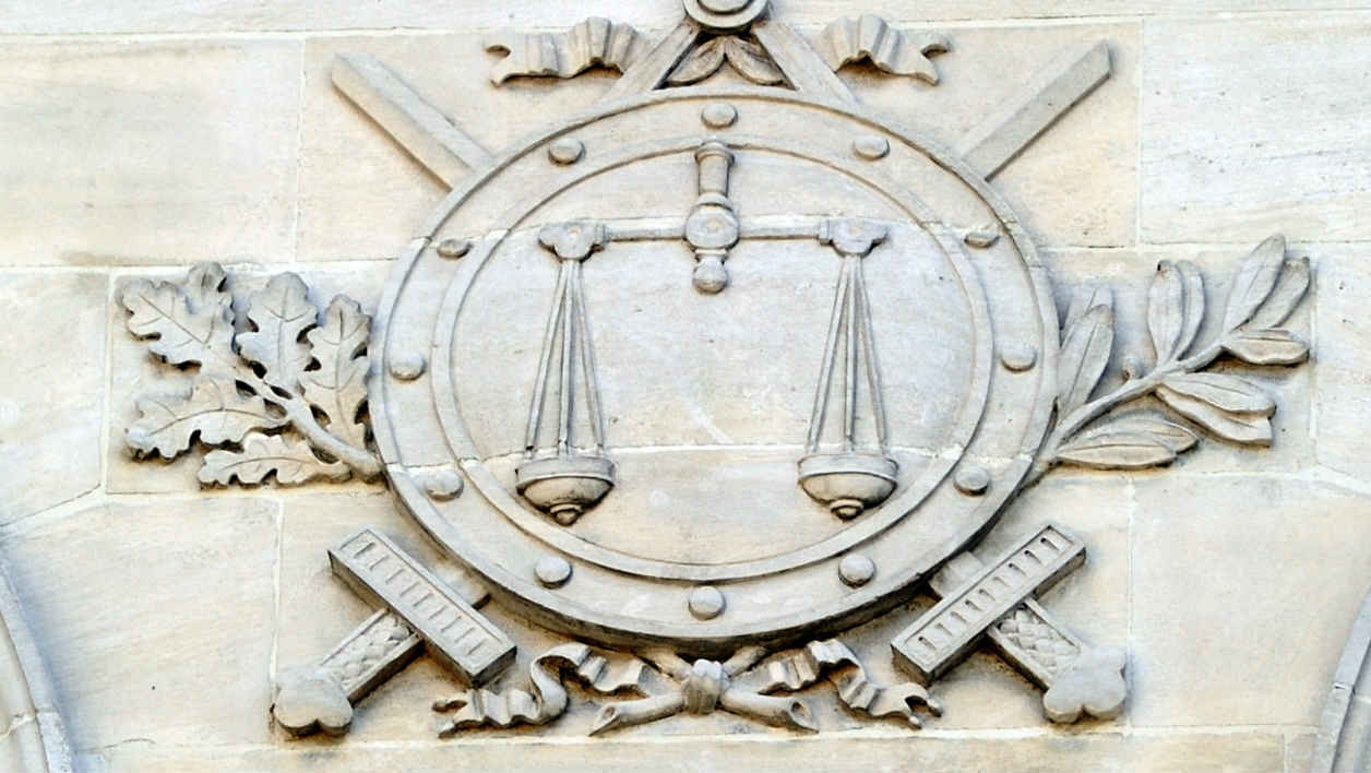 A picture taken on August 17, 2012 shows a high relief on the facade of the Amiens criminal court prior to the hearing of the three young men arrested in connection with rioting that devastated part of the northern city of Amiens earlier this week. Five young men, two of whom are minors, have been detained on suspicion of public order offences on the basis of thermal images taken from a police helicopter during rioting which caused six million euros worth of damage to