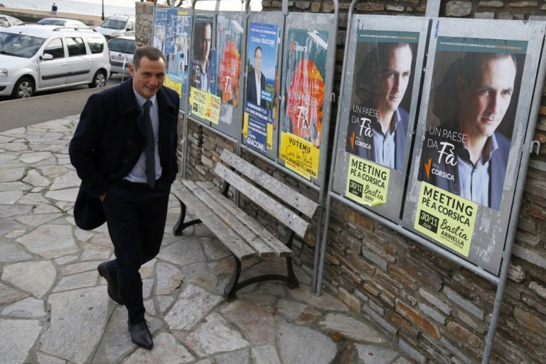 Candidate for the Pe a Corsica nationalist party Gilles Simeoni arrives to vote at a polling station in Bastia on the French Mediterranean Island of Corsica, on December 3, 2017, during the first round of the regional elections.
