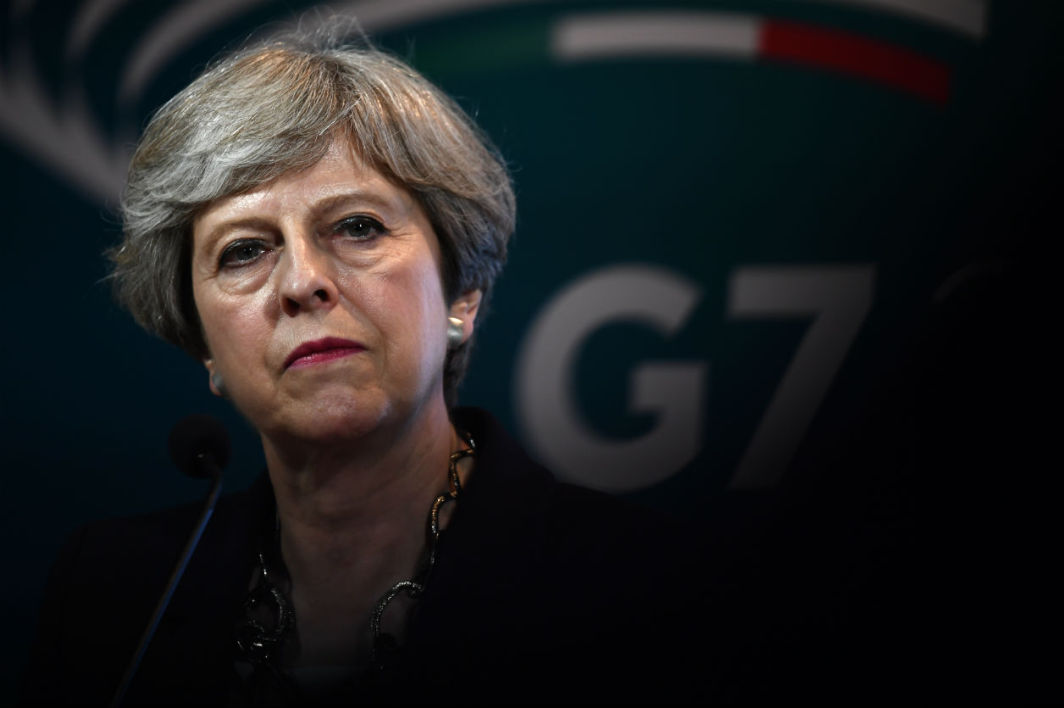 Britain's Prime Minister Theresa May gives a press conference during the Summit of the Heads of State and of Government of the G7, the group of most industrialized economies, plus the European Union, on May 26, 2017 in Taormina, Sicily. JUSTIN TALLIS / AFP