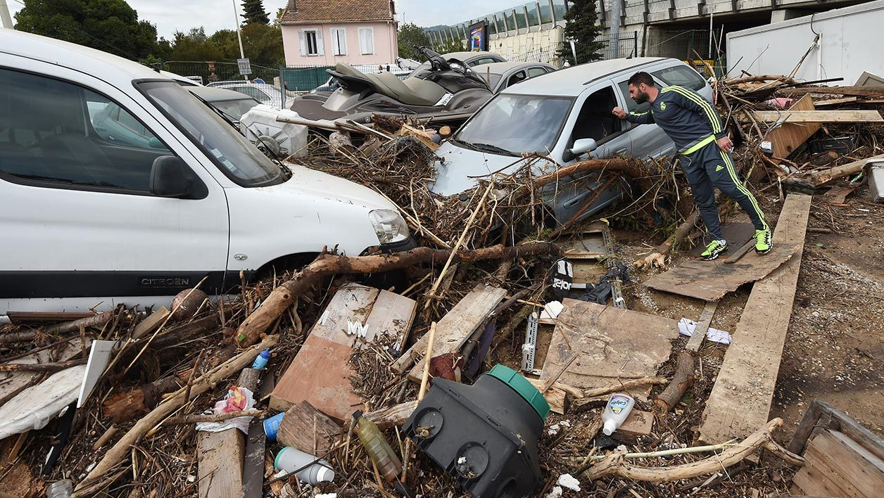 """AFP Photo RÉFÉRENCE DOCUMENT000_PAR8293534 SLUGFRANCE - WEATHER - FLOOD DATE DE CRÉATION06/10/2015 PAYSFRANCE CRÉDITANNE-CHRISTINE POUJOULAT / AFP POIDS FICHIER/PIXELS/DPI46,25 Mb / 4928 x 3280 / 300 dpi FRANCE-WEATHER-FLOOD  A man stands near damaged cars on October 6, 2015 in Cannes, southeastern France, after floods tore through the French Riviera leaving 20 dead. Mediterranean resort towns beloved by jet-setting tourists such as Cannes, Nice and Antibes were devastated by a torrential weekend downpour that trapped residents in cars, parking garages and retirement homes. Rivers of water gushed through some of the world's wealthiest streets, scattering cars hundreds of metres from where they were parked and destroying businesses in what were described as """"apocalyptic"""" scenes. AFP PHOTO / ANNE-CHRISTINE POUJOULAT"""