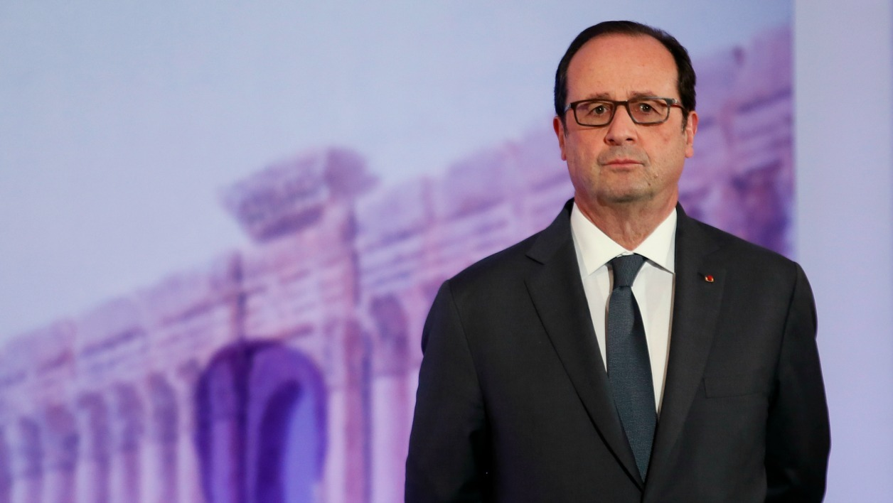 French President Francois Hollande attends the opening of the Palmyra Exhibit, a three-dimensional projection featuring never-before-seen images of Palmyra taken by a drone in April after the city was liberated from IS fighters, at the Grand Palais in Paris on December 13, 2016.