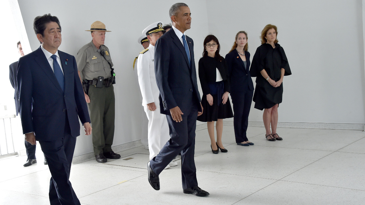 "US President Barack Obama(C) and Japanese Prime Minister Shinzo Abe(L) arrive to place wreaths at the USS Arizona Memorial December 27, 2016 at Pearl Harbor in Honolulu, Hawaii. Abe and Obama made a joint pilgrimage to the site of the Pearl Harbor attack on Tuesday to celebrate ""the power of reconciliation. ""The Japanese attack on an unsuspecting US fleet moored at Pearl Harbor turned the Pacific into a cauldron of conflict -- more than 2,400 were killed and a reluctant America was drawn into World War II. Nicholas Kamm / AFP"
