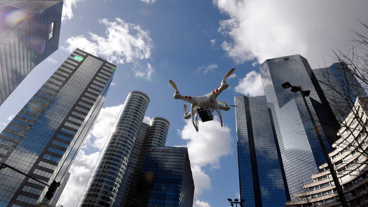 drone An illustration shows a drone flying at La Defense in Paris on February 27, 2015. One of three Al-Jazeera journalists arrested for flying a drone in Paris' Bois de Boulogne park on the western edge of the French capital, for the purposes of a television report, will appear in court next week after pleading guilty, a judicial source said on February 26, 2015. Flying drones over the capital is illegal under French law. AFP PHOTO / DOMINIQUE FAGET