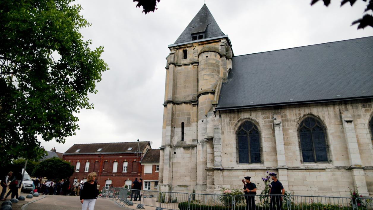 "A picture taken on July 27, 2016 in Saint-Etienne-du-Rouvray shows the church, where a priest was killed the day before in the latest of a string of attacks against Western targets claimed by or blamed on the Islamic State jihadist group. France probes an attack on a church in which two men described by the Islamic State group as its ""soldiers"" slit the throat of a priest. An elderly priest had his throat slit in a church in northern France on July 26 after two men stormed the building and took hostages. The attack in the Normandy town of Saint-Etienne-du-Rouvray came as France was still coming to terms with the Bastille Day killings in Nice claimed by the Islamic State group. CHARLY TRIBALLEAU / AFP"