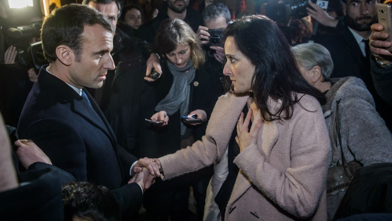 French president Emmanuel Macron (L) shakes hands with Stephanie Colonna, wife of Yvan Colonna, after his visit at the Fesch Museum in Ajaccio, on the French island of Corsica, on February 6, 2018. French president on visit in Corsica is to commemorate Claude Erignac, the state's top representative on the island who was assassinated 20 years ago in a nationalist attack that shocked the country and brought tens of thousands of Corsicans onto the street in protest.