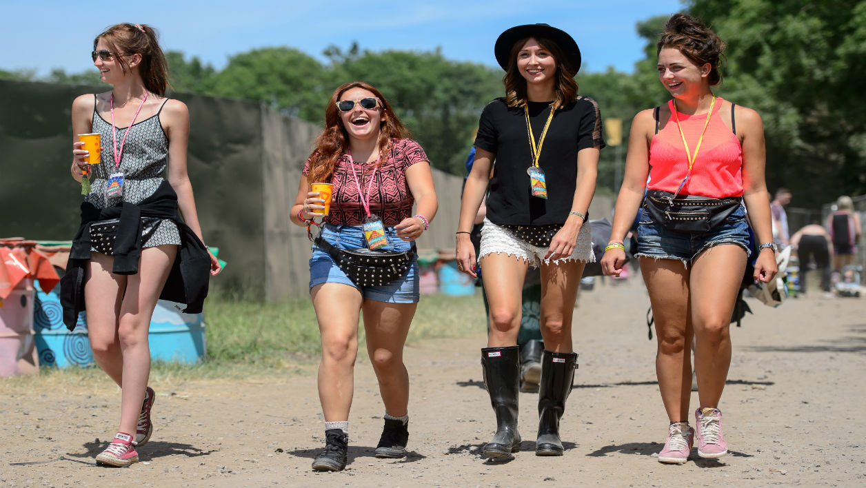 Festival goers arrive with their tents and drink supplies as the gates open at the Glastonbury Festival of Music and Performing Arts in Somerset, south west England, on June 25, 2014.
