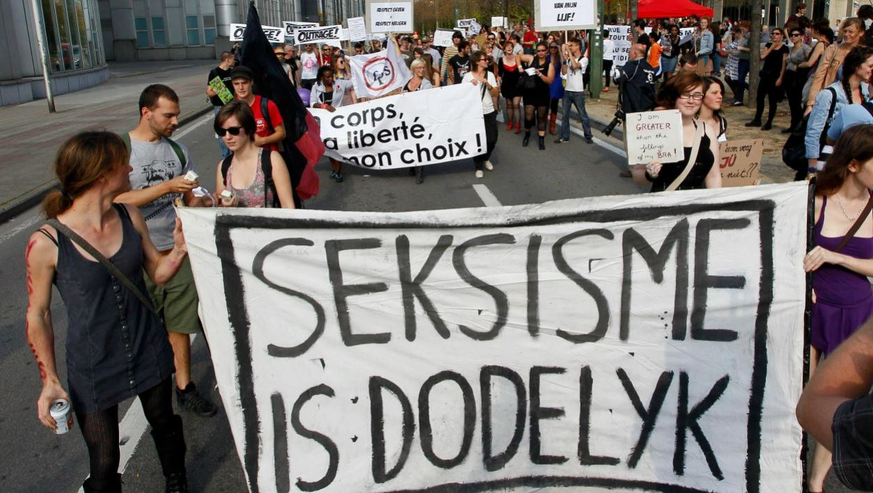 Protestors hold a banner reading 'seksisme is dodelijk' (sexism is deadly) during the Slutwalk demonstration in Brussels on 25 September 2011. Slutwalk is an international protest movement against the claim that sexual violence and discrimination can be legitimized by the way a victim is dressed.