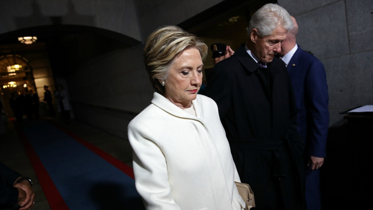 Former Democratic presidential nominee Hillary Clinton and former US President Bill Clinton arrive on the West Front of the US Capitol on January 20, 2017 in Washington, DC.