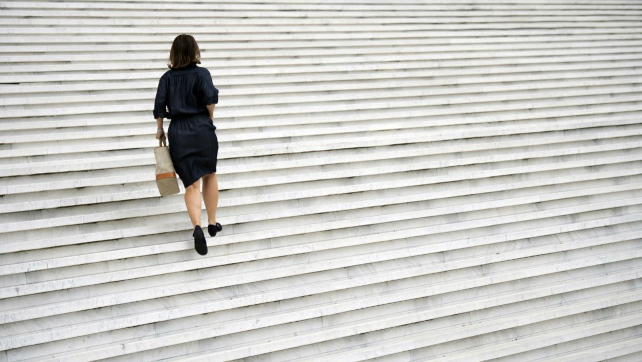 A woman climbs stairs at the La Defense business district, on September 11, 2012 in Nanterre, outside Paris. AFP PHOTO MARTIN BUREAU MARTIN BUREAU / AFP