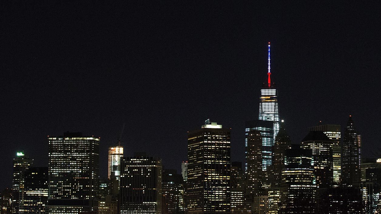 NEW YORK, NY - NOVEMBER 13: One World Trade Center's spire is shown lit in French flags colors of white, blue and red in solidarity with France after tonight's terror attacks in Paris, November 13, 2015 in New York City. According to reports, over 150 people were killed in a series of bombings and shootings across Paris, including at a soccer game at the Stade de France and a concert at the Bataclan theater. Daniel Pierce Wright/Getty Images/AFP