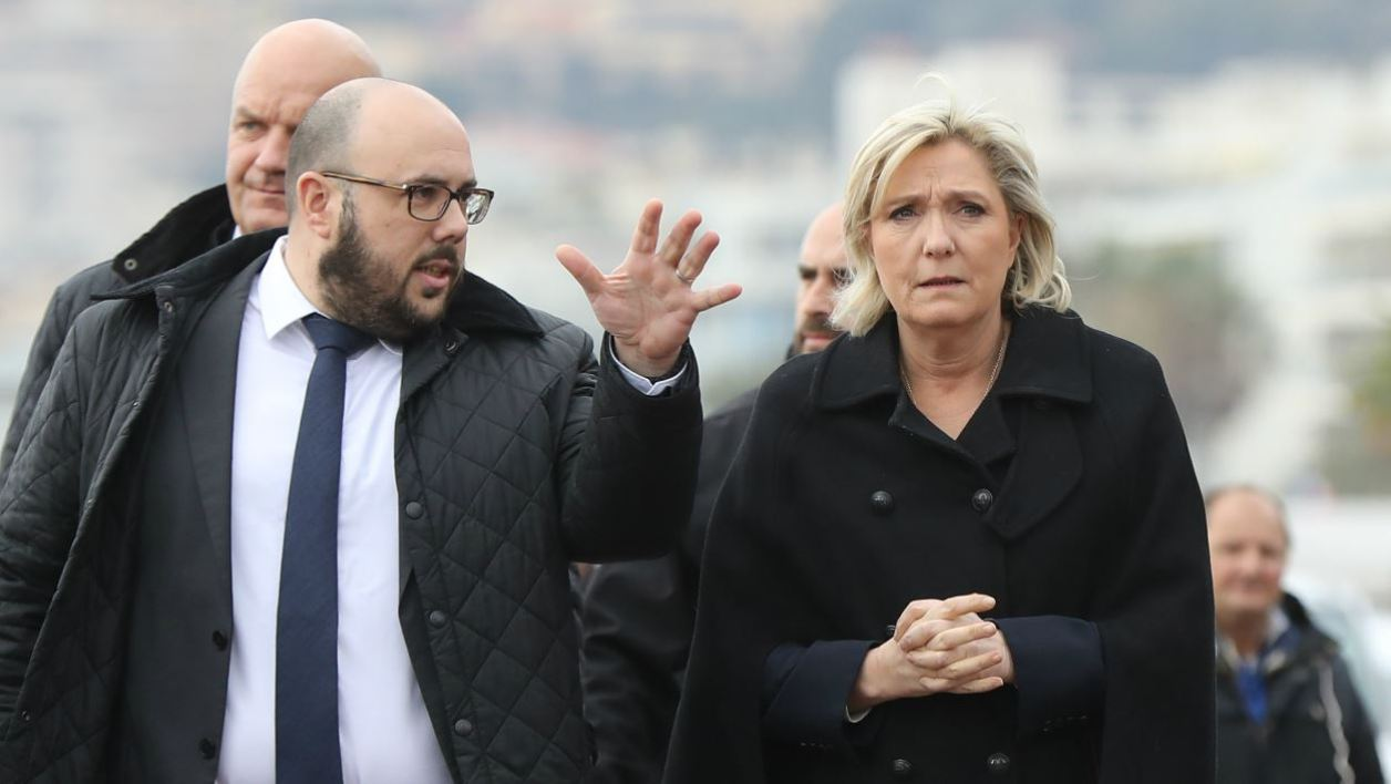 "French presidential election candidate for the far-right Front National (FN) party Marine Le Pen (C), flanked by FN's Provence-Alpes-Côte-d'Azur's Regional council members Philippe Vardon (L) and Olivier Bettati (R), walks on the ""Promenade des Anglais"" as she visits Nice, southeastern France, on February 13, 2017.  VALERY HACHE / AFP"