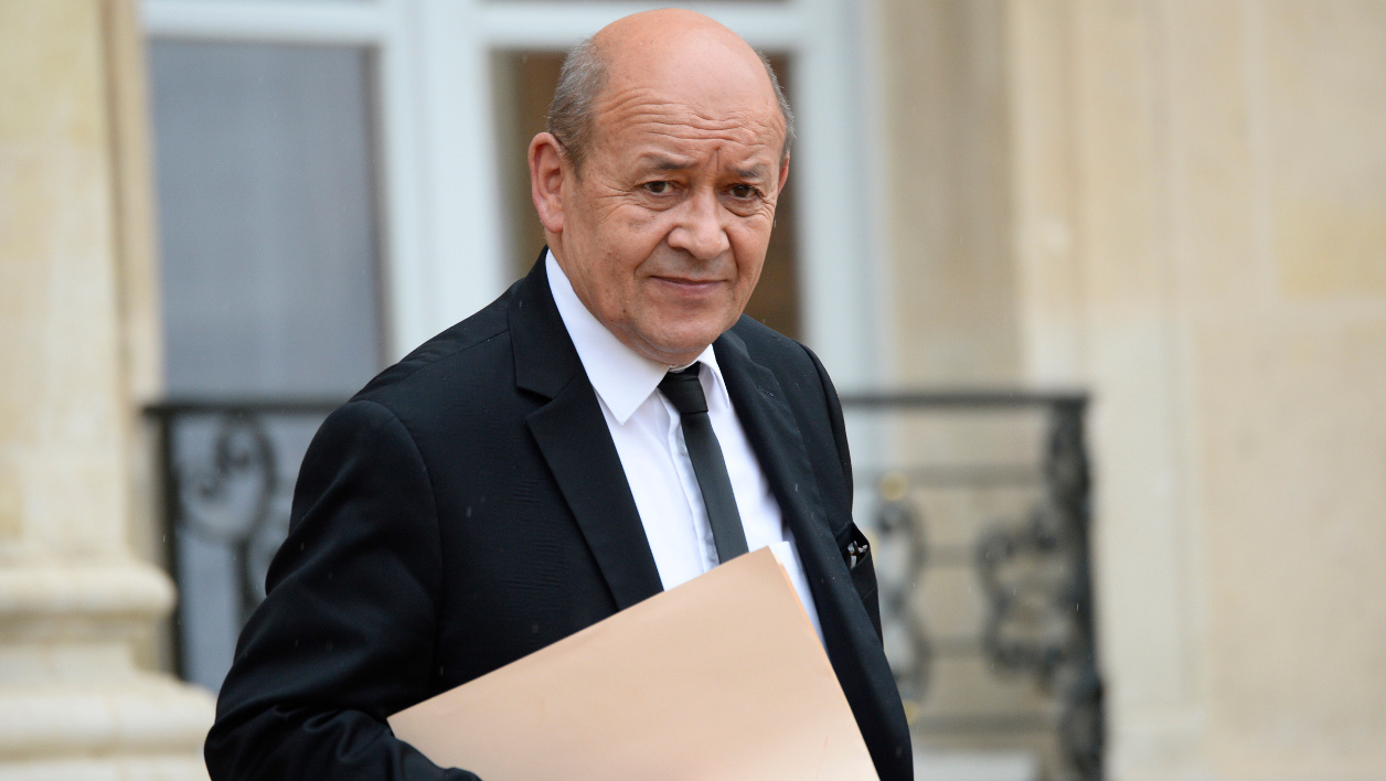 French Defense minister Jean-Yves Le Drian leaves after an extraordinary cabinet meeting, on May 10, 2016 at the Elysee palace in Paris. The meeting is held to allow the presidency to force through a highly contested labour reform without a parliamentary vote. The proposed reform, which would make it easier for employers to hire and fire workers, has sparked waves of sometimes violent protests across France since early March. AFP PHOTO / BERTRAND GUAY  BERTRAND GUAY / AFP