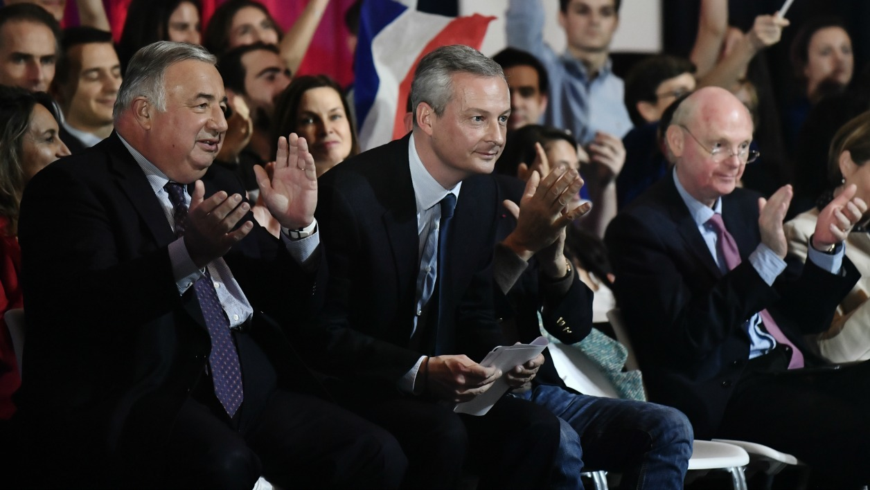 French Senate President Gerard Larcher (L), Bruno Le Maire (C), French right-wing Les Republicains (LR) party member of Parliament and former candidate of the right-wing primaries who did not pass the first round, and Francois Fillon's campaign director Patrick Stefanini (R) attend a campaign rally for Francois Fillon.