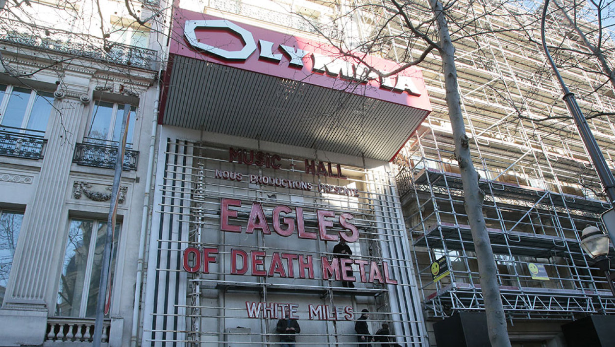"""An employee is at work to set the letter reading """"Eagles of Death Metal"""" on the facade of the Olympia concert hall, on February 16, 2016 in Paris, ahead of the band's concert. Eagles of Death Metal, the Californian rock group who were playing at the Bataclan music hall in Paris when jihadist gunmen burst in and killed 90 people in November, return to the French capital for a concert at Olympia."""