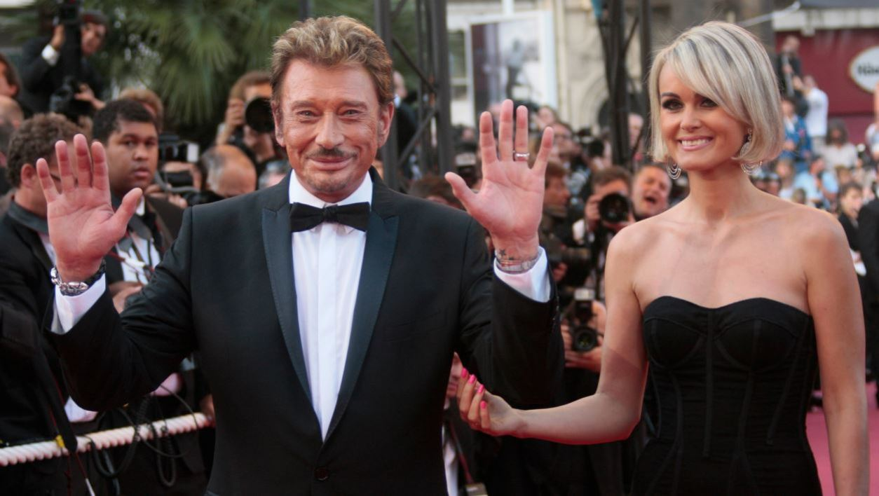 "French actor and singer Johnny Hallyday and his wife Laeticia arrive for the screening of the movie ""Vengeance"", in competition at the 62nd Cannes Film Festival on May 17, 2009. AFP PHOTO / FRANCOIS GUILLOT  FRANCOIS GUILLOT / AFP"