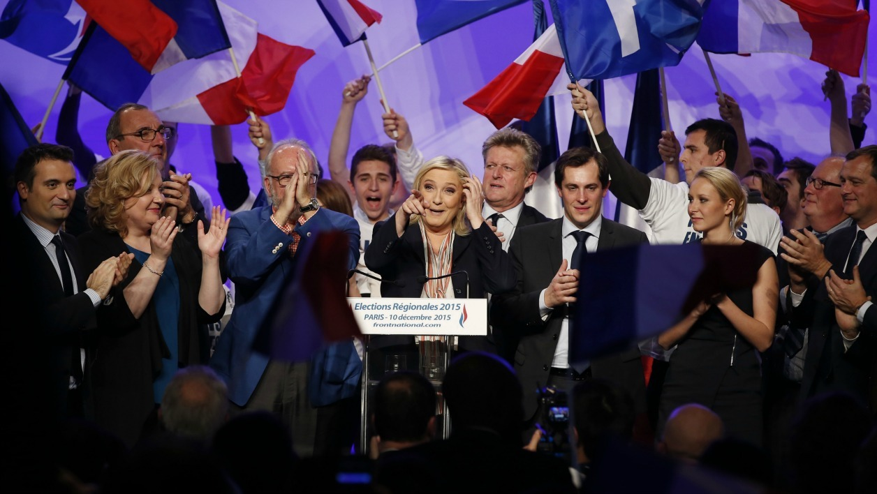 French far-right Front National (FN) President and candidate in the Nord-Pas-de-Calais-Picardie region for the second round of the regional elections, Marine Le Pen (C) addresses supporters during a campaign rally on December 10, 2015 in Paris.  PATRICK KOVARIK / AFP