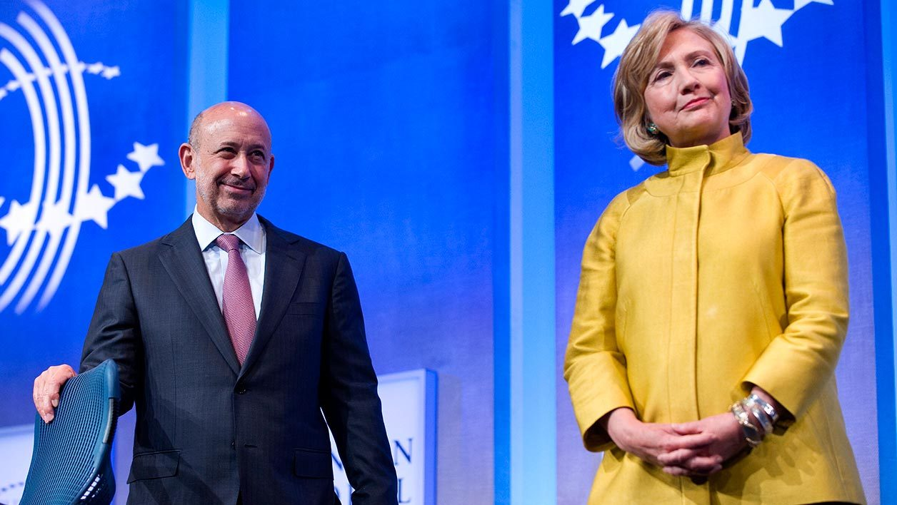 Lloyd Blankfein, Chairman & CEO, Goldman Sachs (L) stands on stage with former US Secretary of State Hillary Clinton during the 2014 Clinton Global Initiative annual meeting in New York September 24, 2014. AFP PHOTO/STEPHEN CHERNIN