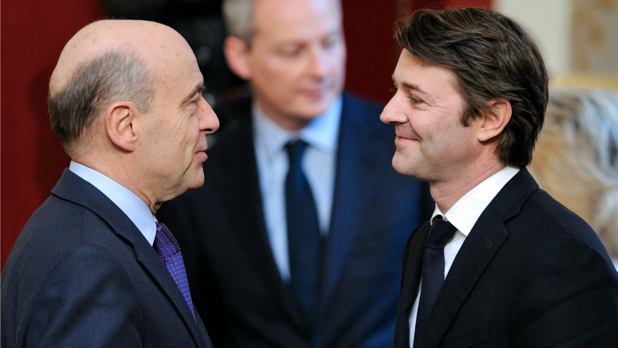 France's Economy Minister Francois Baroin (R), France's Foreign Minister Alain Juppe (L) and France's Agriculture Minister Bruno Le Maire (C) talk together before a press conference of France's President and German Chancellor during a French-German cabinet meeting at the Elysee Palace on February 6, 2012 in Paris.