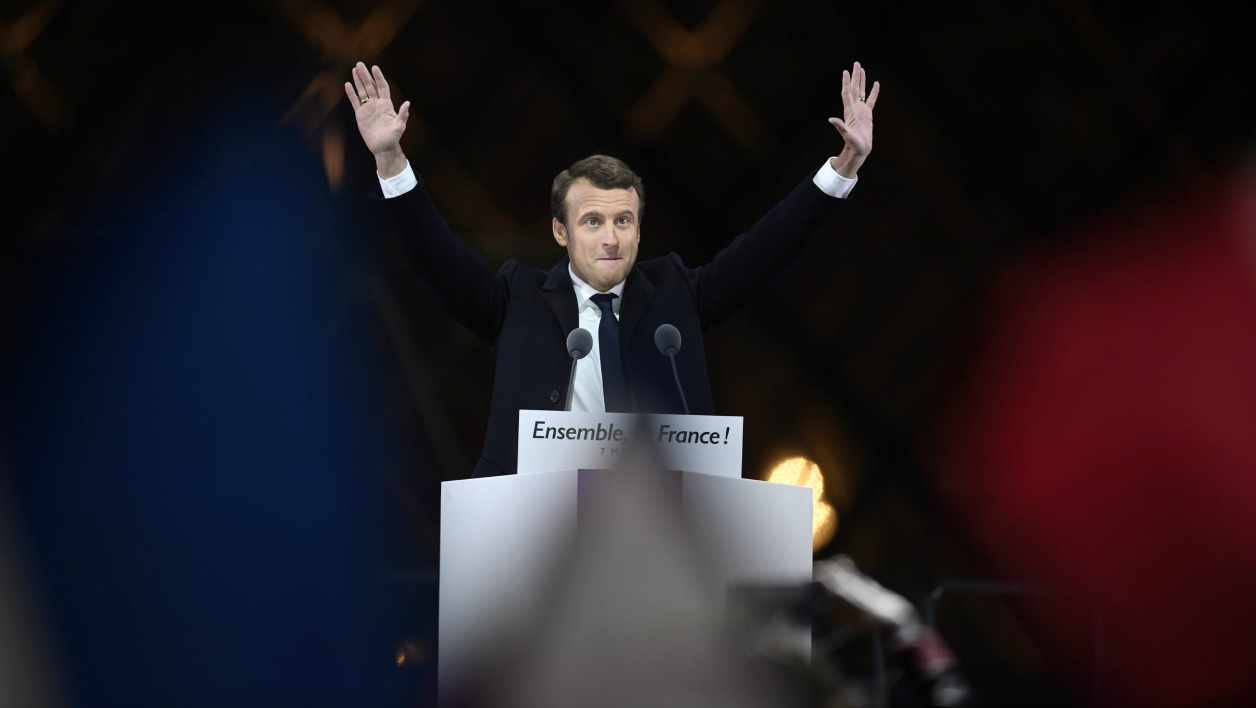 French president-elect Emmanuel Macron greets supporters as he arrives to deliver a speech in front of the Pyramid at the Louvre Museum in Paris on May 7, 2017, after the second round of the French presidential election. Emmanuel Macron was elected French president on May 7, 2017 in a resounding victory over far-right Front National (FN - National Front) rival after a deeply divisive campaign. Eric FEFERBERG / AFP