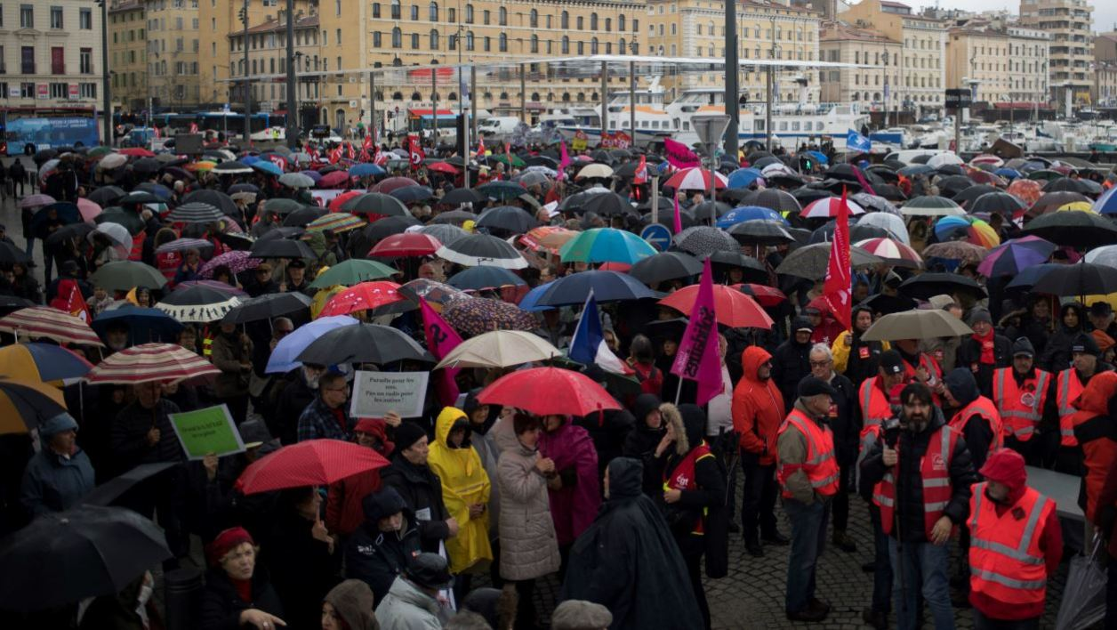 Pensioners demonstrate along with striking EHPAD (Establishment for the Housing of Elderly Dependant People) employees, on March 15, 2018 in Marseille, as part of a nation-wide movement of retired workers to protest against a new hike in a tax taken from their pensions, while EHPAD workers call for more resources. BERTRAND LANGLOIS / AFP