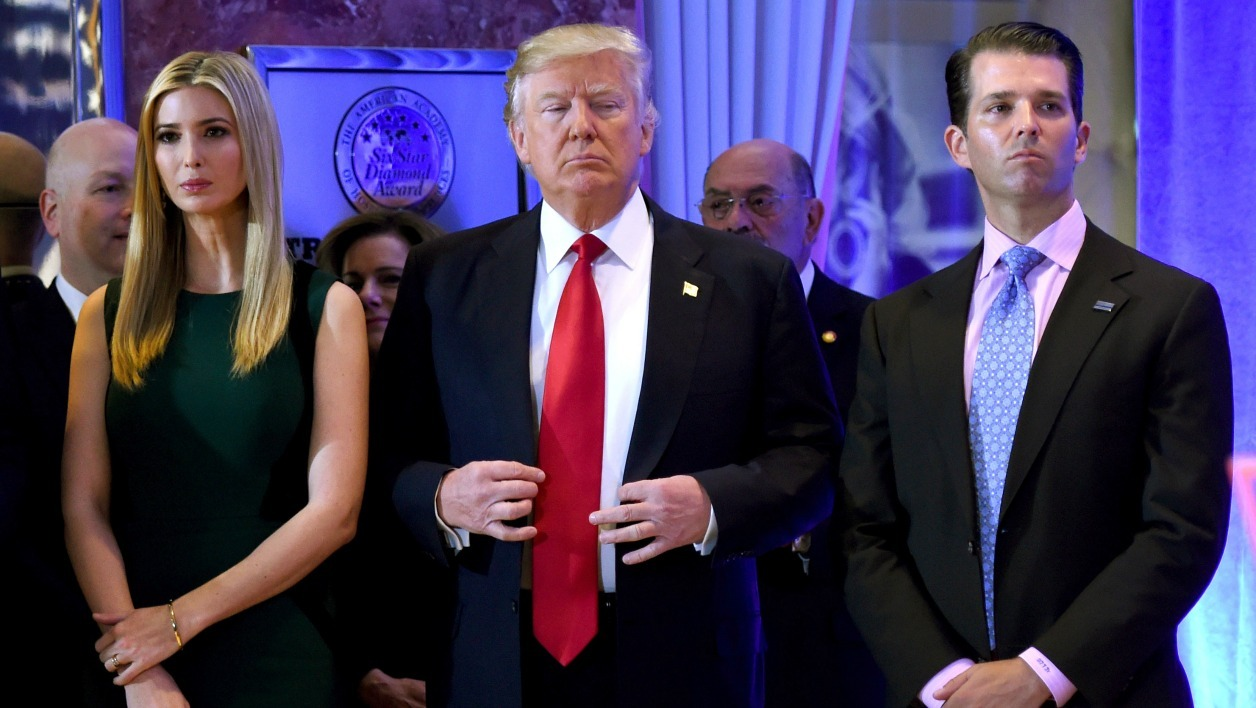 US President- elect Donald Trump stands with his children Ivanka and Donald Jr., during Trump's press conference at Trump Tower in New York on January 11, 2017.  TIMOTHY A. CLARY / AFP